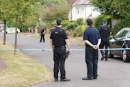 Armed police close a residential street in Claygate, England, on September 10, 2012, near the house of a British family shot dead in the French Alps. Police spent a third day searching the home of the victims and at one time called in a British army bomb squad and neighbouring properties were evacuated. After several hours of tension, it was announced that nothing hazardous had been discovered