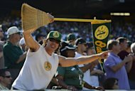 An Oakland Athletics fan holds up a broom for the series sweep against the Texas Rangers at O.co Coliseum, on October 3, in Oakland, California. The Athletics won the game 12-5 capturing the American League West title