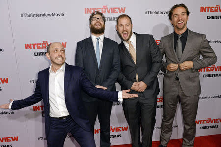 "Dan Sterling, Seth Rogen, Evan Goldberg and James Weaver pose during the premiere of ""The Interview"" in Los Angeles"