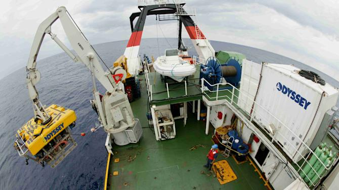 ADDS INFO: OFF THE COAST OF GEORGIA - In this 2003 photo provided by Odyssey Marine Exploration, the company's eight-ton remotely operated vehicle, named Zeus, is launched for a descent to the ocean floor from the ship Odyssey Explorer about 100 miles off the coast of Georgia. Under a deal, approved by Judge Patrick Sheeran of the Franklin County Court of Common Pleas in Columbus, Ohio, on Wednesday, March 5, 2014, the Tampa, Fla.-based company can begin working to recover gold bars and coins from the wreck of the SS Central America next month. (AP Photo/Odyssey Marine Exploration)