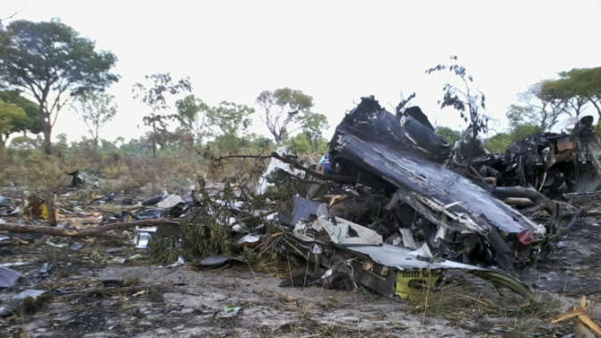 """FILE - This Saturday, Nov. 30, 2013 file photo, shows the wreckage of a Mozambique Airlines plane which crashed Nov. 29, in the Bwabwata National Park, Namibia, killing all 27 passengers and six crew on board. Preliminary investigations shows that the pilot intentionally brought the Mozambican plane down """"There was an intention to crash the plane,"""" Joao Abreu, chairman of the Mozambican Civil Aviation Institute said Saturday Dec. 21, 2013. (AP Photo/NAMPA, Olavi Haikera, FILE)"""