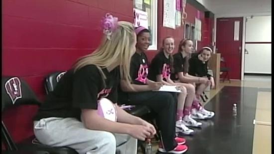 Basketball players shoot for a cure