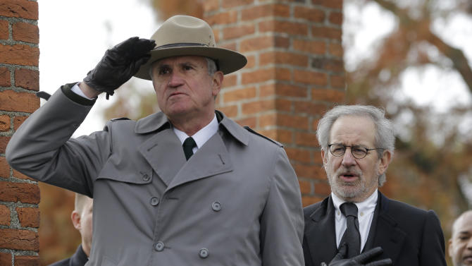 Director Steven Spielberg, right, recites the Pledge of Allegiance alongside Bob Kirby, Superintendent of Gettysburg National Military Park, during a ceremony to mark the 149th anniversary of President Abraham Lincoln's delivery of the Gettysburg Address at Soldier's National Cemetery in Gettysburg, Pa., Monday, Nov. 19, 2012. Spielberg and historian Doris Kearns Goodwin delivered remarks and participated in a wreath-laying ceremony. (AP Photo/Patrick Semansky)