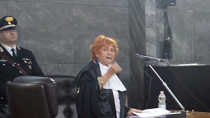 Prosecutor Ilda Boccassini makes her closing arguments during a hearing in former Premier Silvio Berlusconi's sex-for-hire trial, in Milan, Italy, Monday, May 13, 2013. Berlusconi is accused of paying for sex with an underage Moroccan prostitute at a lavish party he hosted while he was premier and then trying to cover it up. The sensational trial reopened just days after Berlusconi's four-year sentence for tax fraud was confirmed by an appeals court, a damaging verdict that nonetheless cannot be enforced until all appeals are exhausted. Boccassini, who is continuing final arguments opened by a colleague in early March, will wrap with sentencing demands later Monday. Barring delays, a verdict could come by the end of the month. (AP Photo/Antonio Calanni)