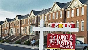 A real estate agent's 'for sale' sign pictured in Centreville, Virginia on June 29, 2014