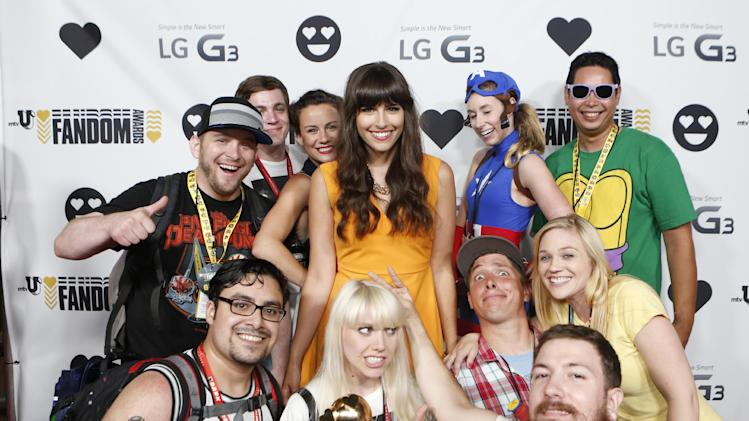 Carly Henderson, center, and fans at the LG G3 booth at the mtvU Fandom Awards at MTV Fan Fest at Comic-Con on Thursday, July 24, 2014, in San Diego. (Photo by Christy Radecic/Invision for MTV/AP Images)