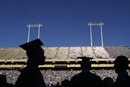 University students are silhouetted during their graduation on May 13, 2009, in Tempe, Arizona. Somewhat fewer US college students are having frequent sex, compared to their Generation X predecessors, but those who do are more likely to be getting it on with a casual date or pal