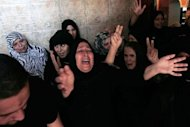 Relatives of Palestinian militant Yasser al-Atal mourn during his funeral in Khan Yunis in the southern Gaza Strip. Two Gazans died in an Israeli strike on Sunday, raising to five the total number killed as Israel pressed a series of raids targeting militants, among them a top Salafist leader