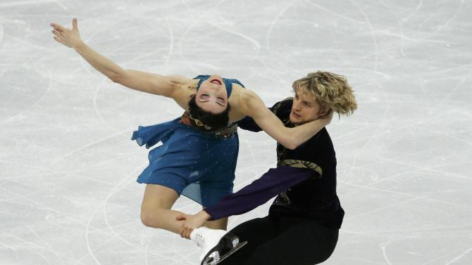 Meryl Davis and Charlie White of the United States figure skating team compete during the Team Ice Dance Free Dance at the Sochi 2014 Winter Olympics