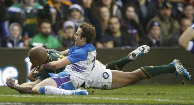 South Africa's Pietersen scores a try as Scotland's Jackson attempts tackle during rugby union match in Edinburgh