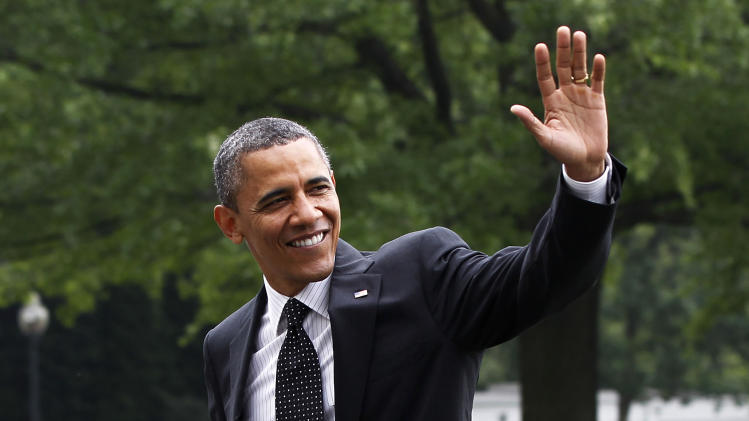President Barack Obama waves as he walks across the South Lawn of the White House in Washington, Wednesday, May 2, 2012, upon his arrival from an unannounced trip to Afghanistan. (AP Photo/Pablo Martinez Monsivais)
