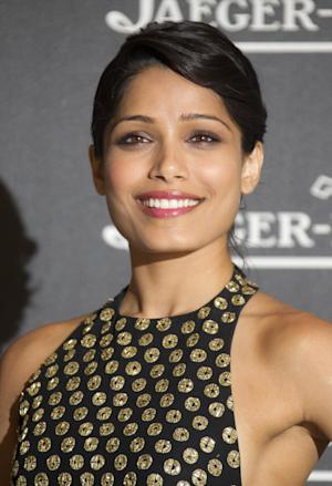 "FILE - In a Tuesday, Sept. 4, 2012 file photo, actress Freida Pinto arrives for a party in Venice, Italy. Pinto introduced ""Girl Rising"", Richard Robbins' new movie, Monday, Jan. 21, 2013 at Sundance Film Festival by sharing some powerful statistics: There are 66 million girls who are not in school; 14 million girls under 18 who will be married this year; and 150 million girls are victims of sexual violence each year.  (AP Photo/Joel Ryan, File)"