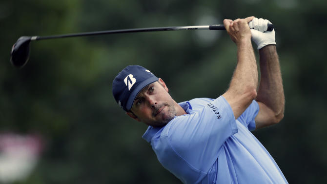 Matt Kuchar watches his tee shot on the 11th hole during the second round of the Colonial golf tournament on Friday, May 24, 2013, in Fort Worth, Texas. (AP Photo/LM Otero)