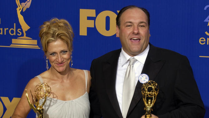 FILE - This Sept. 21, 2003 file photo shows actors Edie Falco, left, and James Gandolfini  with the awards they won for outstanding lead actress and actor in a drama series for their work on The Sopranos at the 55th Annual Primetime Emmy Awards at the Shrine Auditorium in Los Angeles. HBO and the managers for Gandolfini say the actor died Wednesday, June 19, 2013, in Italy. He was 51.(AP Photos/Mark J. Terrill, file)