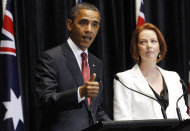 U.S. President Barack Obama and Australian Prime Minister Julia Gillard speak at a joint news conference at Parliament House in Canberra, Australia, Wednesday, Nov. 16, 2011. (AP Photo/Charles Dharapak)