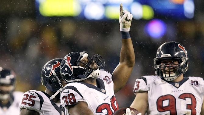 Houston Texans free safety Danieal Manning (38) celebrates after intercepting a pass against the Chicago Bears in the first half an NFL football game in Chicago, Sunday, Nov. 11, 2012. (AP Photo/Nam Y. Huh)