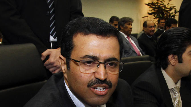 Qatar's Minister of Energy and Industry Mohammed Bin Saleh Al-Sada speaks to journalists prior to the start of the meeting of the Organization of the Petroleum Exporting Countries, OPEC, at their headquarters in Vienna, Austria, Wednesday, Dec. 12, 2012 . (AP Photo/Ronald Zak)