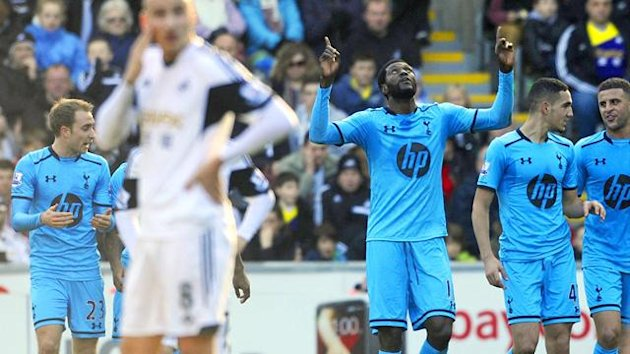 Emmanuel Adebayor celebrates his second goal against Swansea (Reuters)