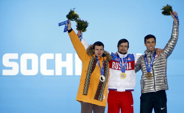 Gold medallist Tretiakov of Russia, silver medallist Dukurs of Latvia and bronze medallist Antoine of the U.S. celebrate during the victory ceremony for the men's skeleton event at the 2014 Sochi