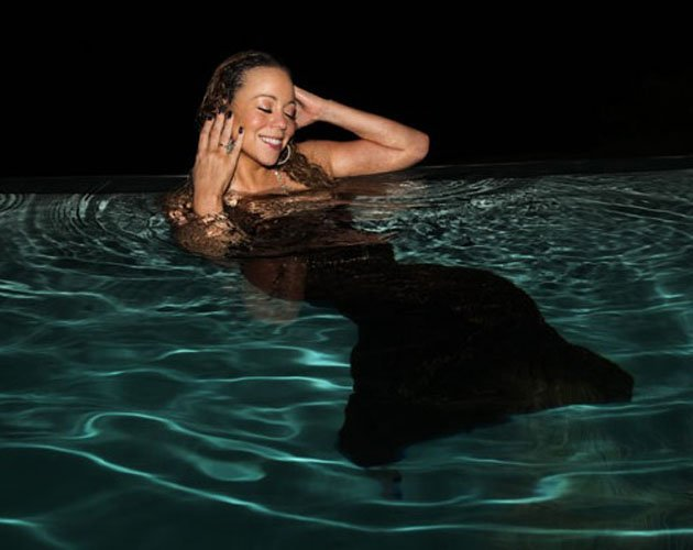 Mariah Carey poses in swimming pool in a ball gown (as you do ...