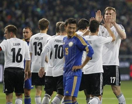 Germany's national soccer team players celebrate a goal during their 2014 World Cup qualifying soccer match against Kazakhstan in Astana