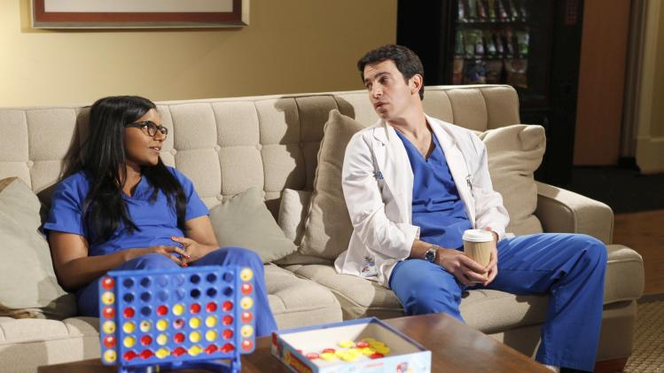 """This image released by Fox shows Mindy Kaling, left, and Chris Messina in a scene from """"The Mindy Project,"""" premiering Sept. 25 at 9:30 p.m. on Fox. (AP Photo/Fox, Beth Dubber)"""