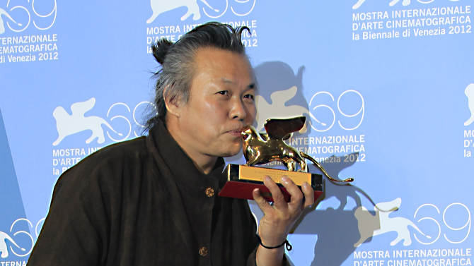 Director KIM ki-duk poses with the Golden Lion he won for his movie 'Pieta' at the awards photo call during the 69th edition of the Venice Film Festival in Venice, Italy, Saturday, Sept. 8, 2012. (AP Photo/Joel Ryan)