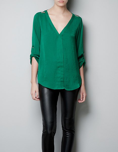 Blouse with studded shoulders, $59.90, zara.com