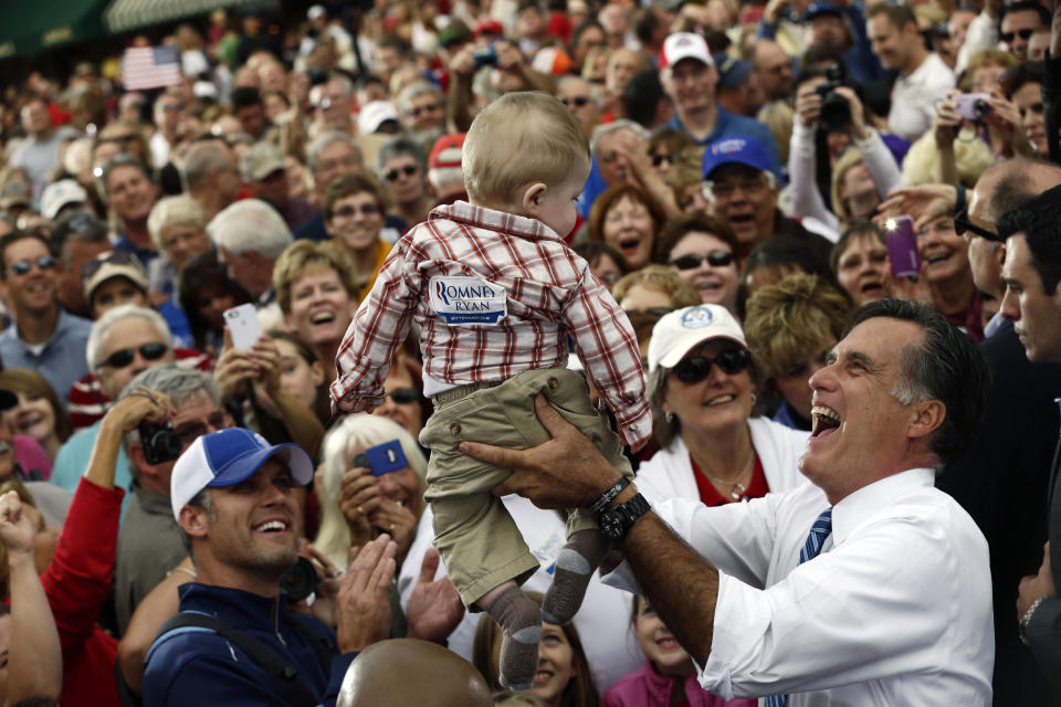 Republican presidential candidate and former Massachusetts Gov. Mitt Romney picks up a baby as he campaigns at The Golden Lamb restaurant in Lebanon, Ohio, Saturday, Oct. 13, 2012. (AP Photo/Charles Dharapak)