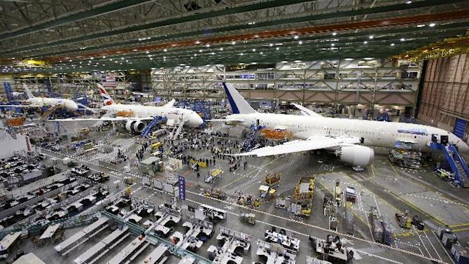 This photo taken May 29, 2013 shows a line of Boeing 787 jets sitting on the floor nearing completion at the company's production plant in Everett, Wash. Federal aviation officials say Boeing's design and manufacture of its cutting-edge 787 jetliner is safe despite the many plane's many problems since its rollout. A report issued jointly by the Federal Aviation Administration and Boeing on Wednesday says the plane was soundly designed, and that the government had effective processes in place to identify and correct issues that emerged before and after certification. The report makes seven recommendations for further improvements by Boeing and FAA. (AP Photo/Elaine Thompson)