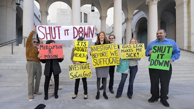 Residents and supporters stand outside Los Angeles City Hall during a demonstration ahead of the testimony before the Los Angeles City Council on the ongoing natural gas leak in the Porter Ranch area of Los Angeles