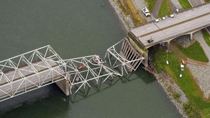 A collapsed section of the Interstate 5 bridge over the Skagit River is seen in an aerial view Friday, May 24, 2013. Part of the bridge collapsed Thursday evening, sending cars and people into the water when a an oversized truck hit the span, the Washington State Patrol chief said. Three people were rescued from the water. Washington Gov. Jay Inslee on Friday declared a state of emergency in three counties around the bridge, saying that the bridge collapse has caused extensive disruption, impacting the citizens and economy in Skagit, Snohomish and Whatcom Counties. (AP Photo/The Seattle Times, Mike Siegel)
