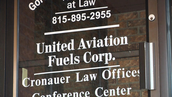 "This undated photo provided by the Regional Transportation Authority in Chicago shows the door for United Aviation Fuels Corp., a subsidy of United Airlines, at a small office building in Sycamore, Ill. The RTA filed a lawsuit Monday, Jan. 14, 2013, alleging that United Airlines is falsely claiming to buy jet fuel out of what it calls this ""sham"" office in rural Illinois since 2001 to avoid paying tens of millions of taxes in Chicago, where it says the purchases are actually being made. (AP Photo/Regional Transportation Authority)"