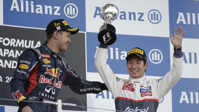 Race winner Red Bull driver Sebastian Vettel of Germany congratulates Sauber driver Kamui Kobayashi, right, of Japan after his third place finish the Japanese Formula One Grand Prix at the Suzuka Circuit in Suzuka, Japan, Sunday, Oct. 7, 2012. (AP Photo/Mark Baker)