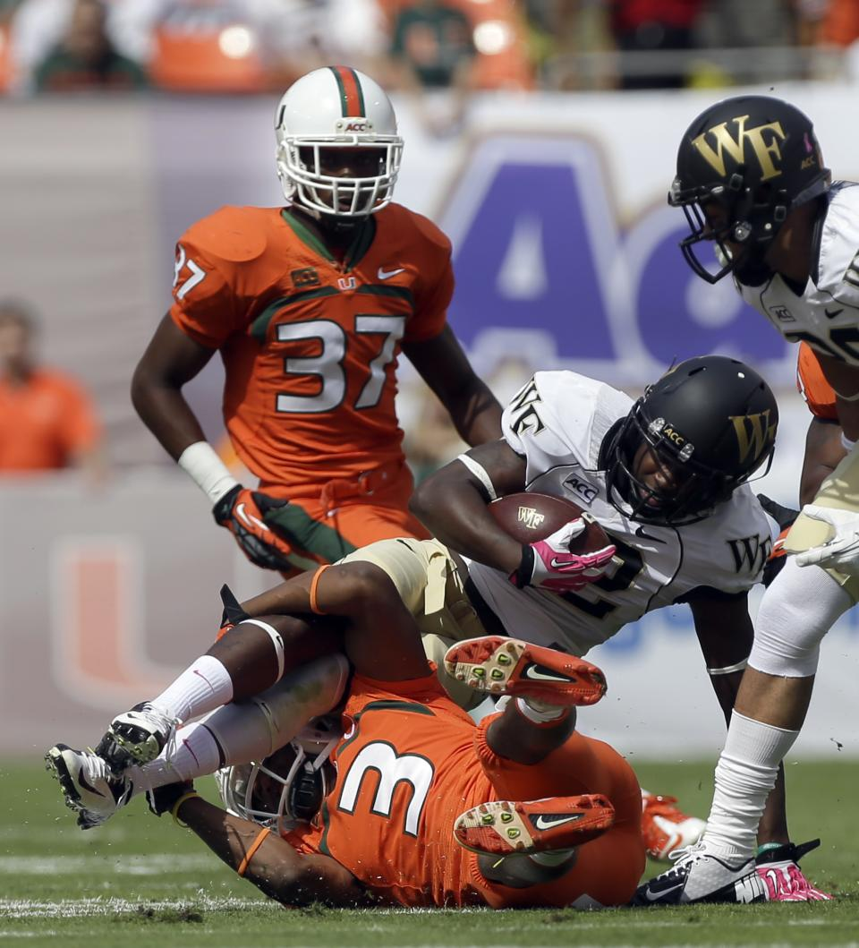 Johnson scores late, No. 7 Miami tops Wake 24-21