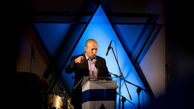 In this Wednesday, Dec. 26, 2012 photo, Naftali Bennett, head of the Jewish Home party, speaks in Ashdod, Israel. The charismatic new leader of Israel's Jewish religious right is siphoning a large chunk of votes from the prime minister's party, according to polls ahead of Jan. 22 elections, and if the trend continues, the high-tech millionaire and former commando could emerge as a powerful voice opposing Palestinian statehood. (AP Photo/Ariel Schalit)
