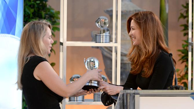 "Dana Delany, right, presents Tara Grace,Vice President of HBO Films, on behalf of Dante DiLoreto, the Television Academy Honors award for ""The Normal Heart"" at the 8th annual Television Academy Honors at the Montage hotel on Wednesday, May 27, 2015, in Beverly Hills, Calif. (Photo by Phil McCarten/Invision for the Television Academy/AP Images)"