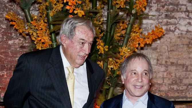 "In this May 2, 2012 photo provided by the Turkana Basin Institute, paleoanthropologist Richard Leakey, left, attends a fundraiser for the Turkana Basin Institute with his friend Paul Simon, who was the guest performer in New York. The Kenyan-born scientist, who serves as a professor at Stony Brook University on New York's Long Island, just spent a month in New York raising funds for his Turkana Basin Institute in Kenya. Leakey predicts skepticism over evolution will soon be history sometime in the next 15 to 30 years. ""If you get to the stage where you can persuade people on the evidence, that it's solid, that we are all African, that color is superficial, that stages of development of culture are all interactive,"" Leakey says, ""then I think we have a chance of a world that will respond better to global challenges."" (AP Photo/Ralph R. Smith)"