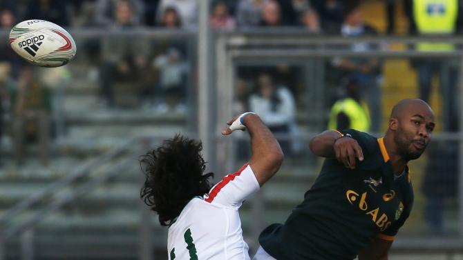 Italy's McLean jumps for the ball with South Africa's Pietersen during their rugby test match in Padua