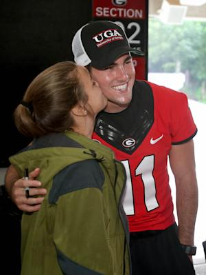 Georgia quarterback Aaron Murray (11) gets a kiss on the cheek from Georgia fan Emily Moore, 14, of Athens, Ga., during Georgia Fan Day at Sanford Stadium on Saturday afternoon, Aug. 17, 2013, in Athens, Ga. (AP Photo/Atlanta Journal Constitution, Jason Getz) MARIETTA OUT GWINNETT OUT LOCAL TV OUT: WXIA-TV, WGCL-TV