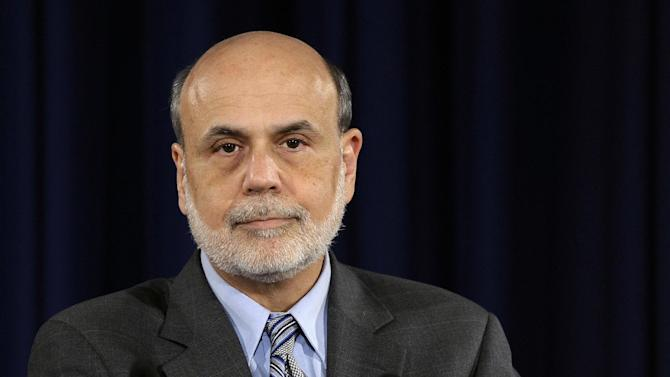 FILE - In this Wednesday, Sept. 18, 2013, file photo, Federal Reserve Chairman Ben Bernanke sits down to speak at a news conference at the Federal Reserve in Washington. Thanks to the partial shutdown of the government, many analysts don't think the Fed will reduce its stimulus before next year (AP Photo/Susan Walsh, File)
