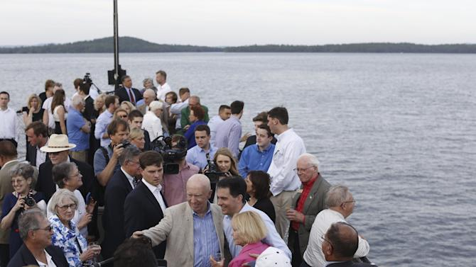 Wisconsin Governor Scott Walker takes a photo with supporters during a sunset cruise with the Belknap County Republicans in Laconia