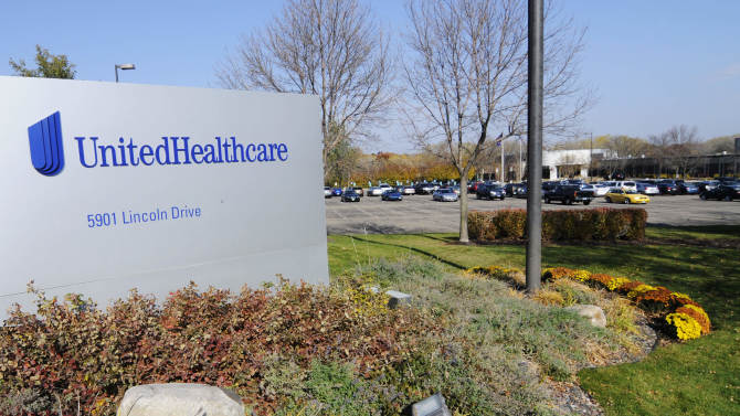 In this Tuesday, Oct. 16, 2012, photo, part of the UnitedHealth Group, Inc. campus is shown, in Minnetonka, Minn. UnitedHealth Group Inc.'s fourth-quarter net income slipped 1 percent, as growing medical costs countered revenue gains for the nation's largest health insurer.  The Minnetonka, Minn., company said Thursday, Jan. 16, 2012 it earned $1.24 billion, or $1.20 per share, in the three months that ended Dec. 31. That compares with $1.26 billion, or $1.17 per share, in the last quarter of 2011.(AP Photo/Jim Mone)