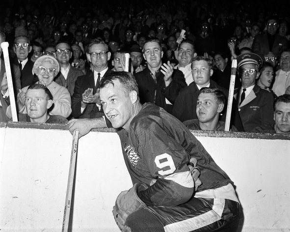 """FILE- In this Nov. 10, 1963 file photo, the Detroit Red Wings' Gordie Howe (9) acknowledges applause from the fans during a 20-minute standing ovation after he scored the 545th cgoal of his National Hockey League career at Detroit's Olympia Stadium, to set the leagues' to set the all-time scoring mark. The NHL has the best names in the business. Nicknames, that is. Little Ball of Hate. The Great One. Tazer. Bicksy. How is known as the """"Mr. Hockey."""" (AP Photo/File)"""