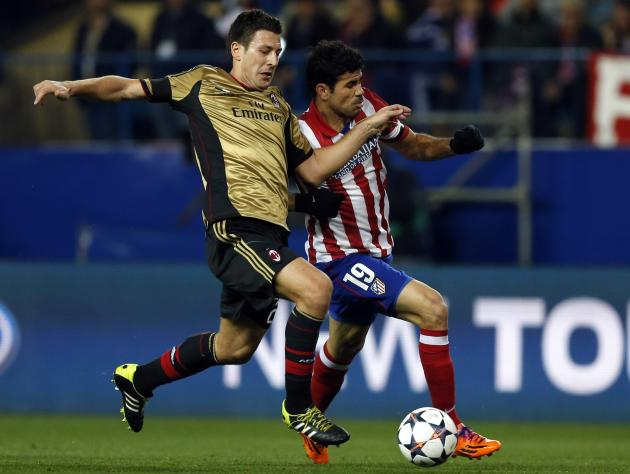 Atletico Madrid's Diego Costa fights for the ball with AC Milan's Daniele Bonera during their Champions League last 16 second leg soccer match at Vicente Calderon stadium in Madrid