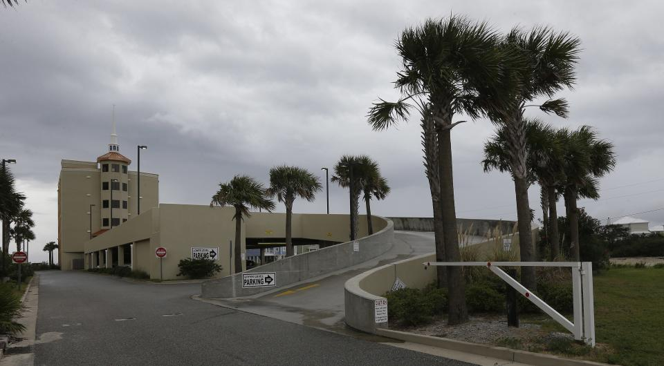 Stiff winds and stormy skies blanket the Romar Beach Baptist Church in Orange Beach, Ala., Sunday, Oct. 6, 2013. The hurricane proof church built on the beach held several services Sunday despite the declining weather brought on by tropical storm Karen in the Gulf of Mexico. (AP Photo/Dave Martin)