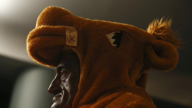"A man dressed in a costume attends the draw for Spain's Christmas Lottery ""El Gordo"" in Madrid"