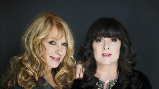 """This Oct. 1, 2012 file photo shows sisters Nancy, left, and Ann Wilson from Heart in New York. The eclectic group of rockers Rush and Heart, rappers Public Enemy, songwriter Randy Newman, """"Queen of Disco"""" Donna Summer and bluesman Albert King will be inducted into the Rock and Roll Hall of Fame April 18, 2013, in Los Angeles. (Photo by Victoria Will/Invision/AP)"""
