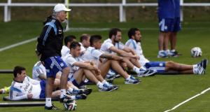Argentina's coach Sabella stands next to Messi during a training session ahead of their 2014 World Cup final match against Germany in Vespasiano