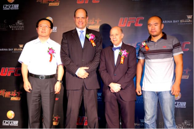 Mark Fischer, Managing Director, UFC Asia (second from left) and Zhang Tiequan, China's first-ever UFC fighter (right). (Photo: UFC)
